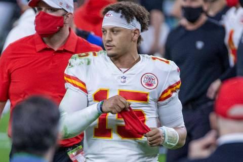 Kansas City Chiefs quarterback Patrick Mahomes (15) walks off the field after defeating the Las ...