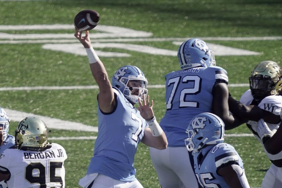 In this Nov. 14, 2020, file photo, North Carolina quarterback Sam Howell (7) passes against Wak ...
