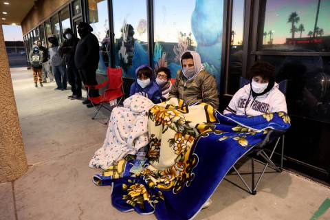Anwar Ouaddi, 12, from left, Iliass Khould, 16, Mo Khould, 17, and Adam Ouaddi, 16, stay warm w ...