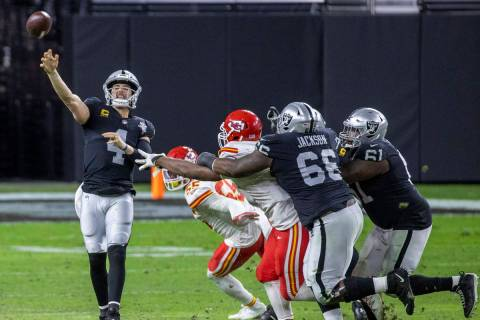 Las Vegas Raiders quarterback Derek Carr (4) gets off a pass under pressure by the Kansas City ...