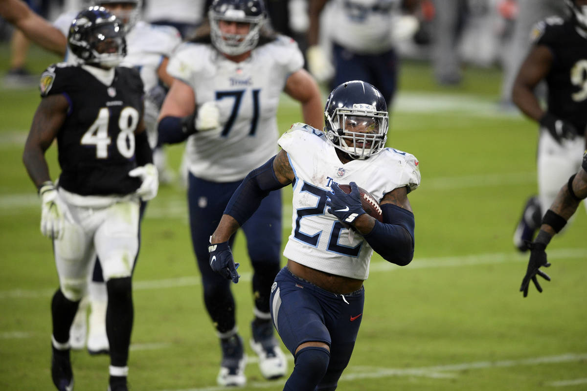 Tennessee Titans running back Derrick Henry (22) runs for a game-winning touchdown against the ...