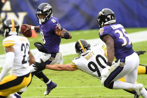 Baltimore Ravens quarterback Lamar Jackson (8) runs the ball against Pittsburgh Steelers outsid ...