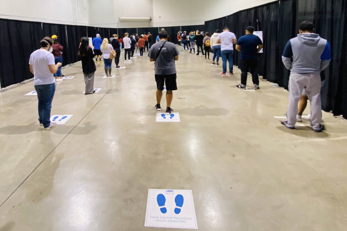People wait in line for COVID-19 testing offered at Cashman Center on Wednesday, Nov. 18, 2020, ...