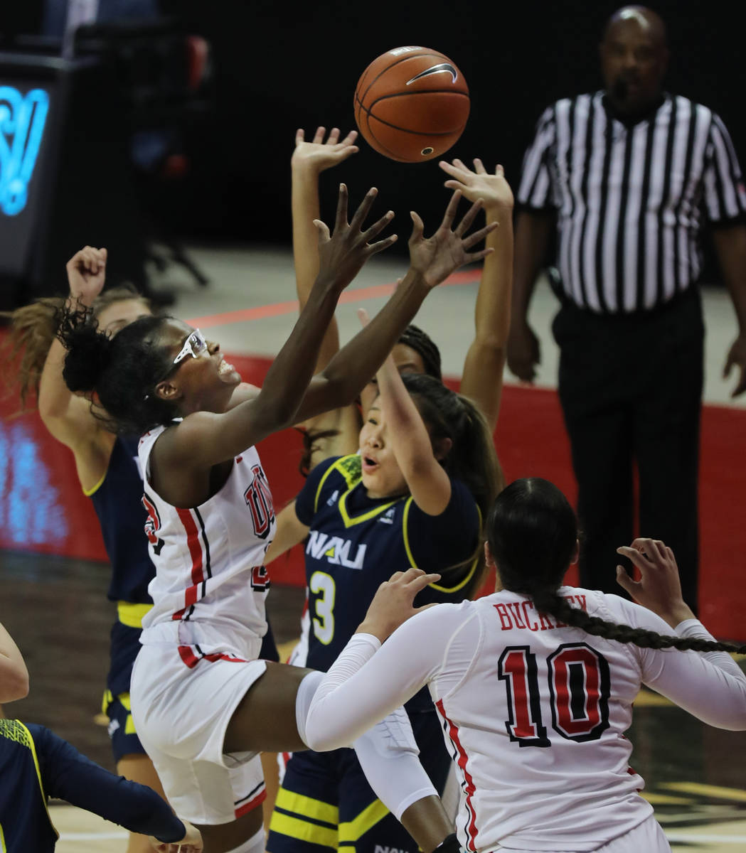 UNLV Lady Rebels forward Desi-Rae Young (23, left) reaches for the rebound over the top of Nort ...