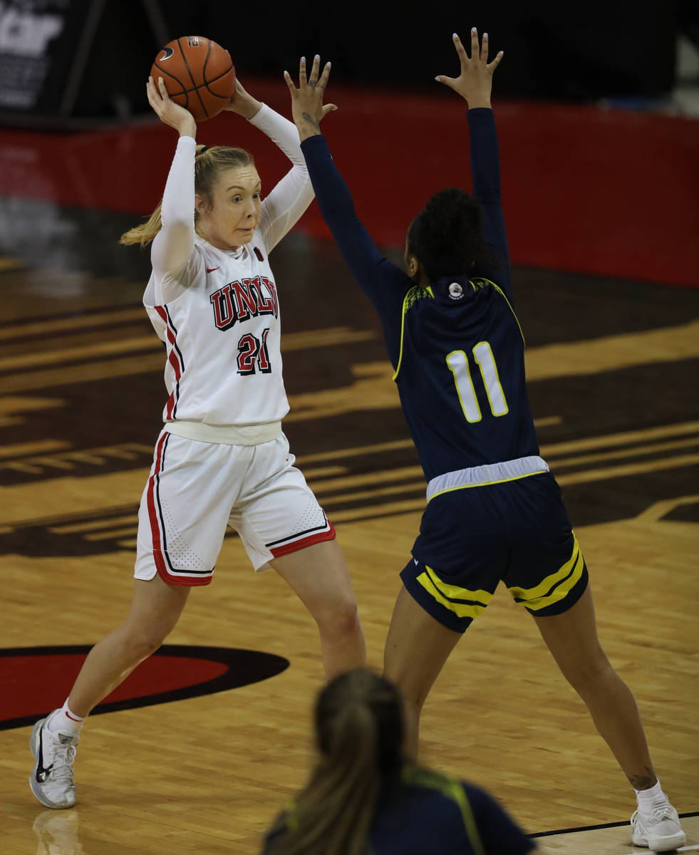 UNLV Lady Rebels forward Delaying Byrne (21, left) gets over the top of Northern Arizona Univer ...