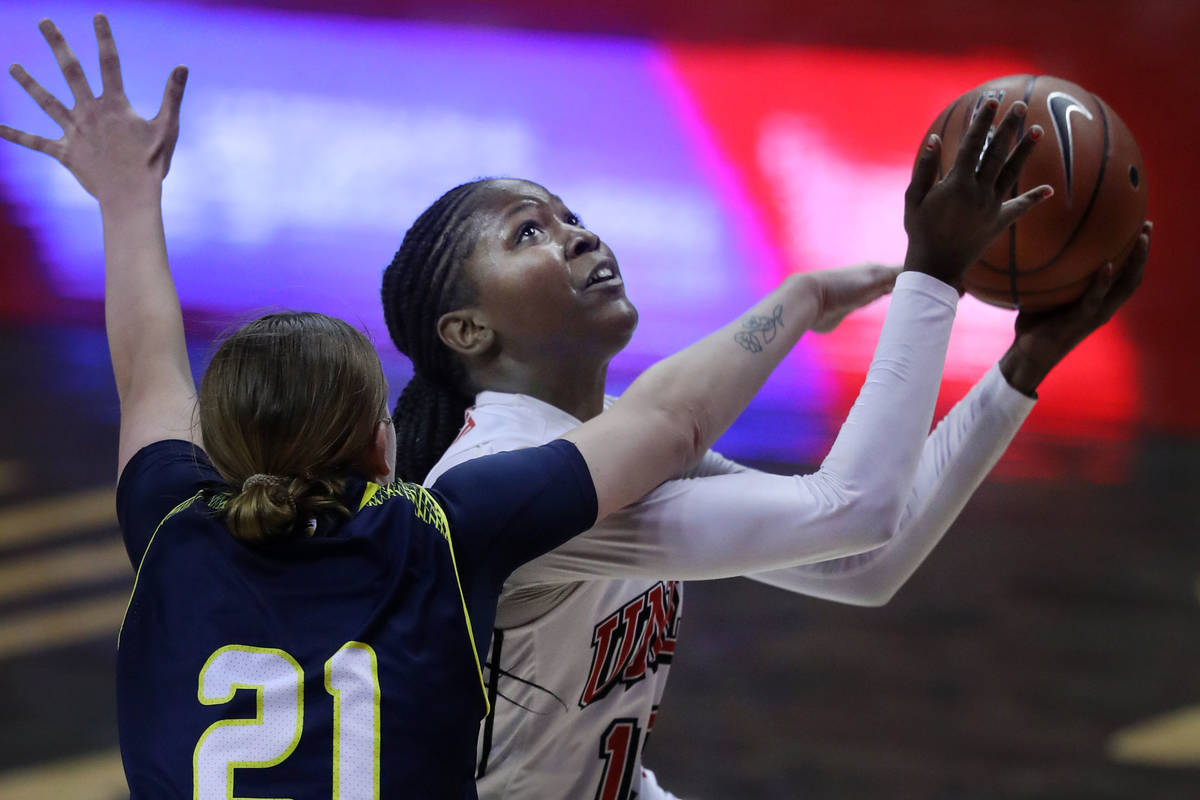 Northern Arizona University guard Jacey Bailey (21, left) tries to block UNLV Lady Rebels forwa ...