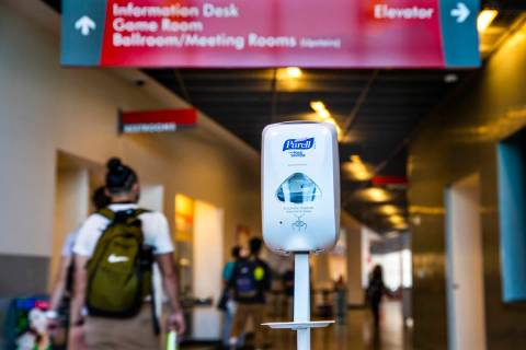 A hand sanitizer dispenser is installed for use at the entrance to the UNLV Student Union build ...