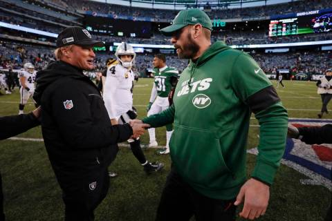 Oakland Raiders head coach Jon Gruden, left, shakes hands with New York Jets head coach Adam Ga ...