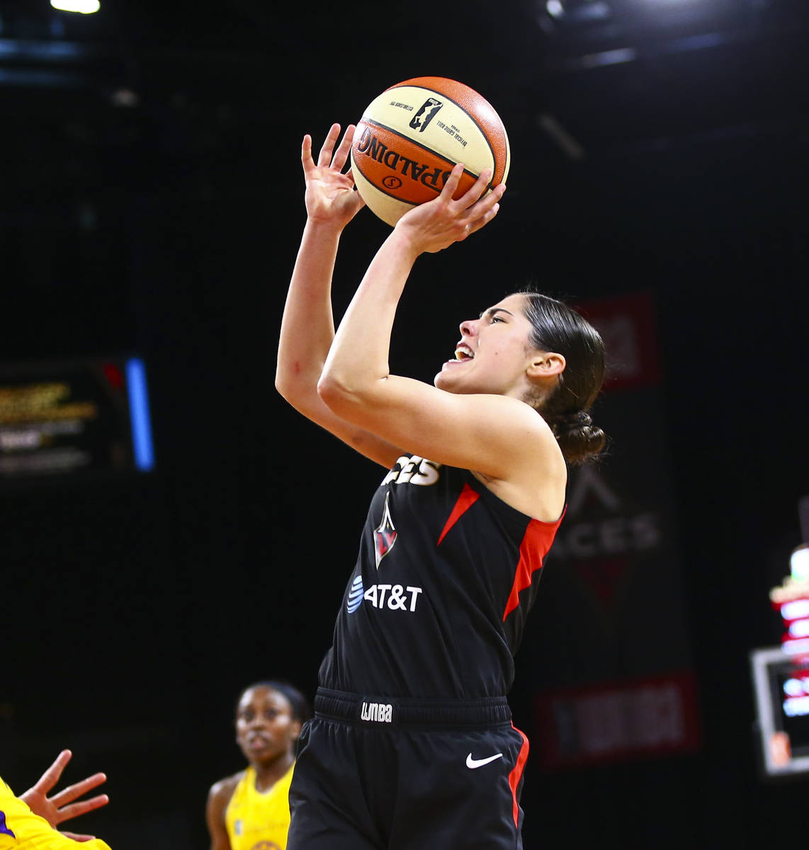 Las Vegas Aces' Kelsey Plum shoots against the Los Angeles Sparks during the second half of a W ...