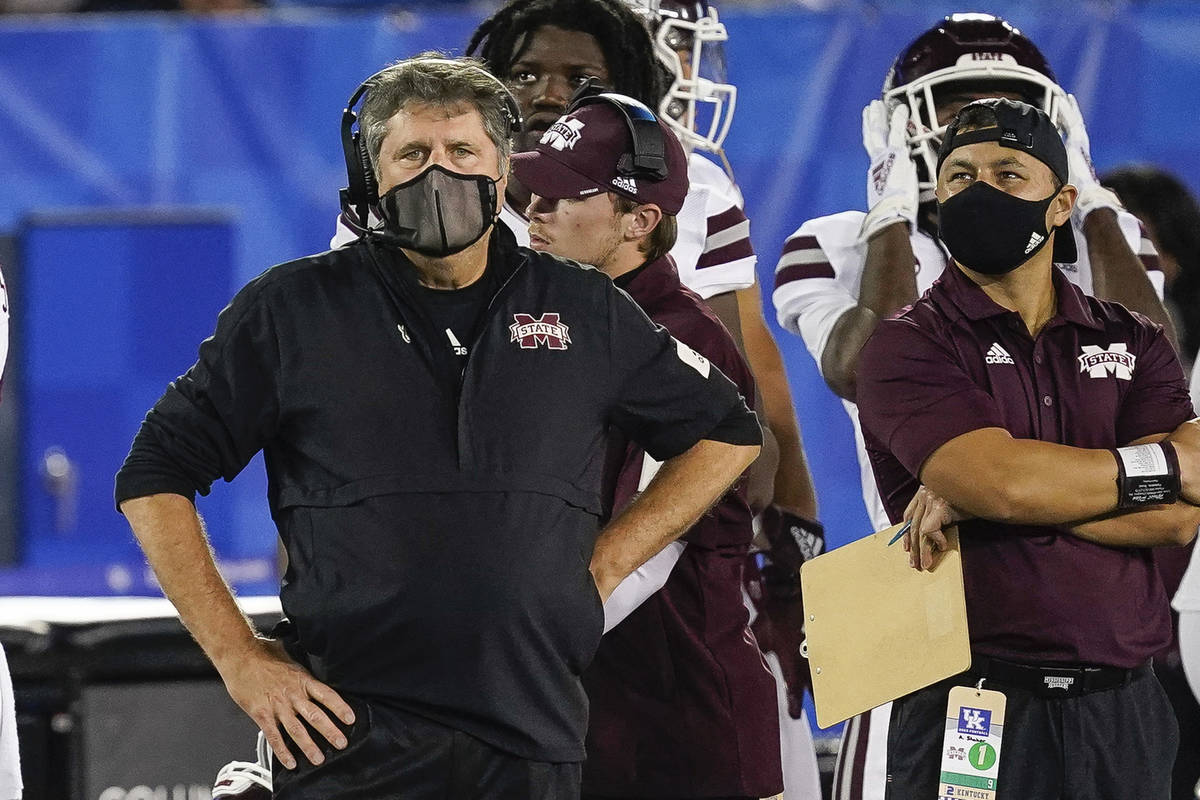 In this Saturday, Oct. 10, 2020, file photo, Mississippi State coach Mike Leach stands on the s ...