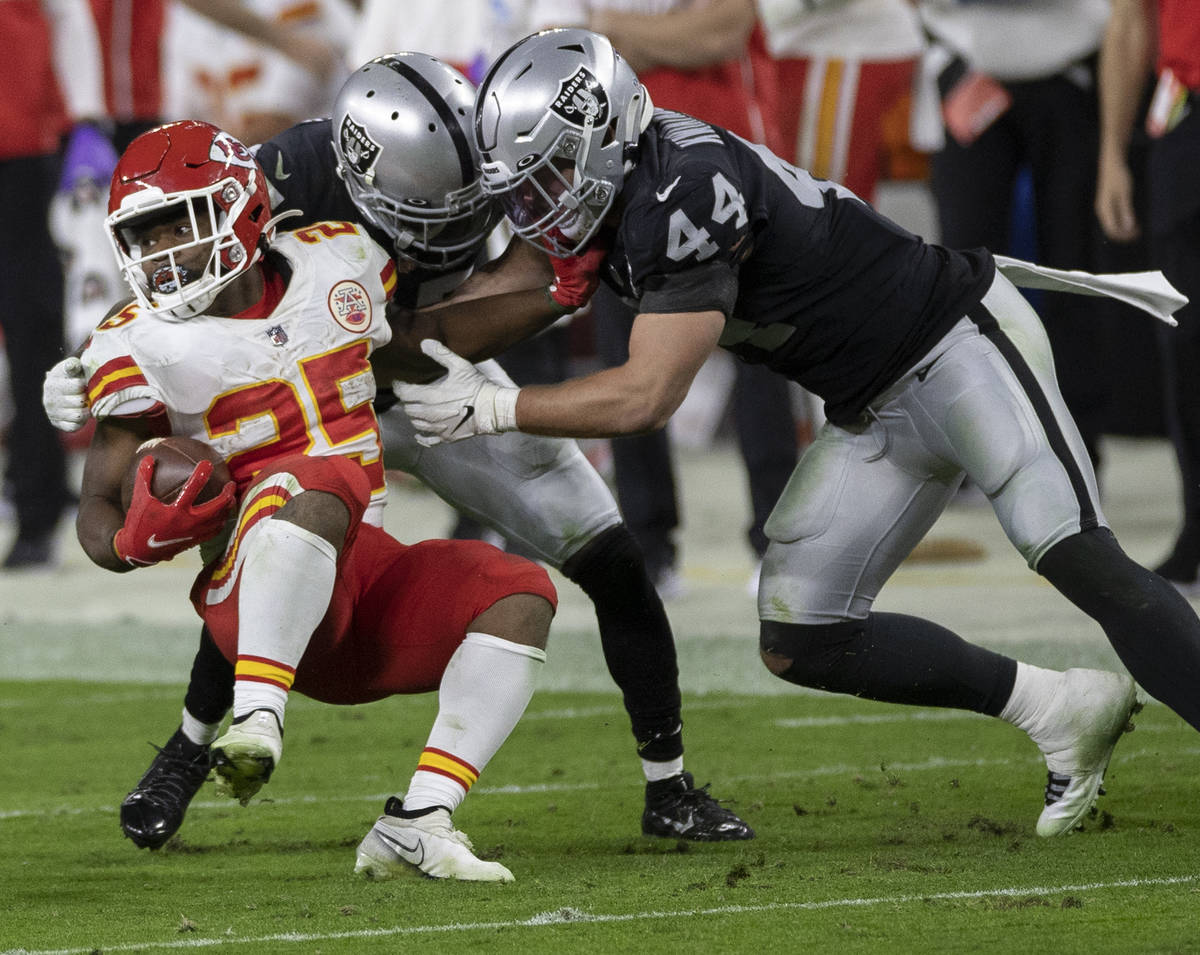 Kansas City Chiefs running back Clyde Edwards-Helaire (25) is tackled by Las Vegas Raiders insi ...