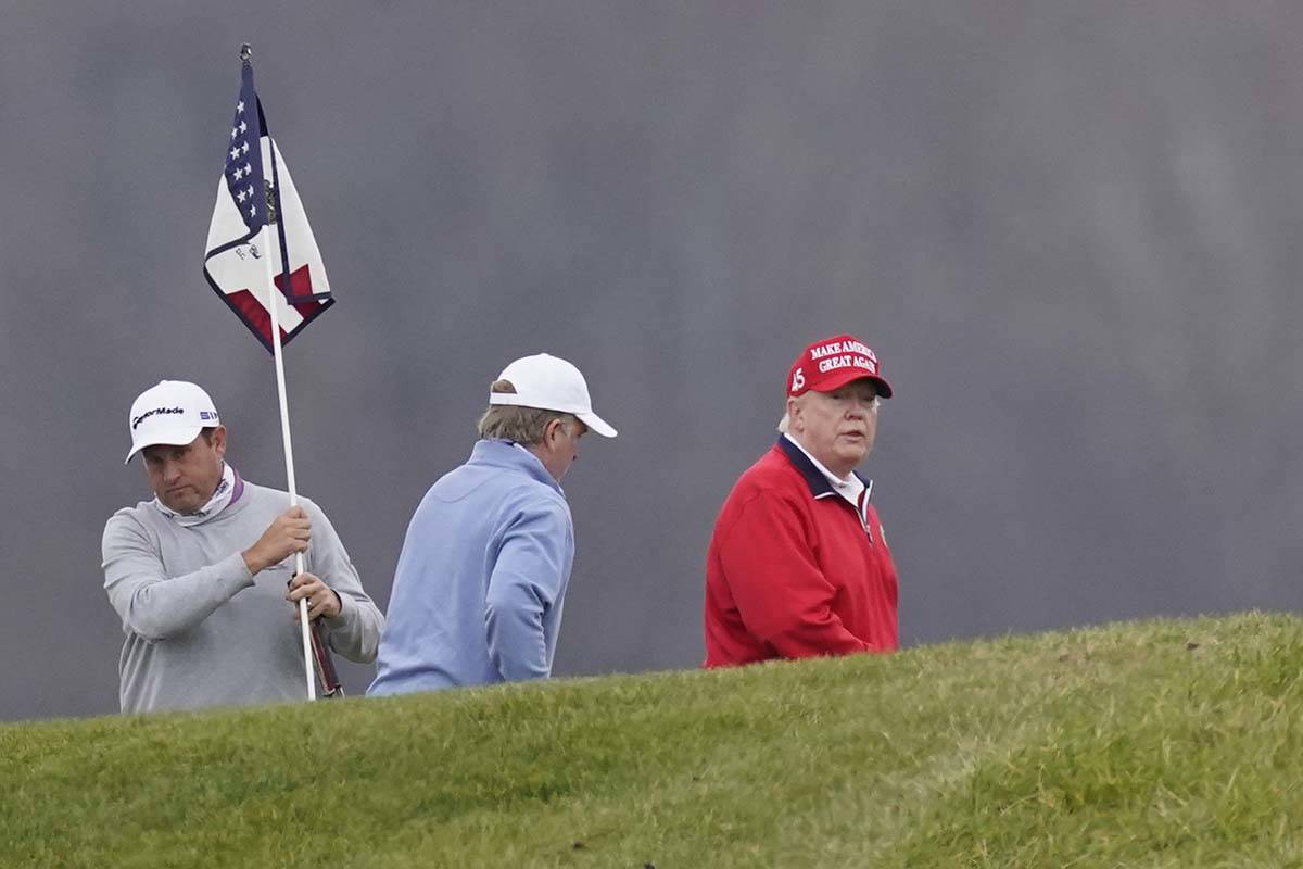 President Donald Trump plays golf at Trump National Golf Club, Friday, Nov. 27, 2020, in Sterli ...