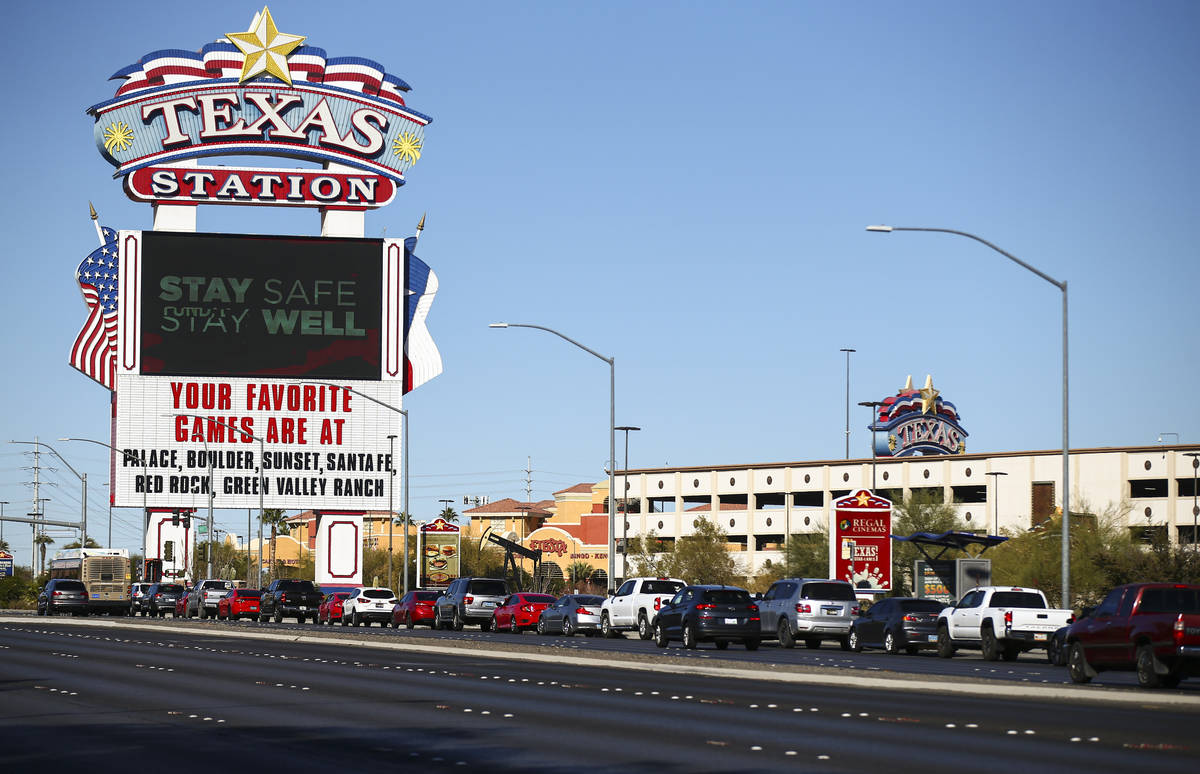 People wait in line at the drive-thru COVID-19 testing site at Texas Station in North Las Vegas ...