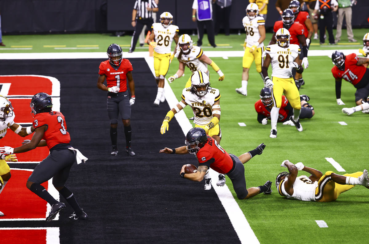 UNLV Rebels quarterback Max Gilliam (6) scores a touchdown against the Wyoming Cowboys during t ...