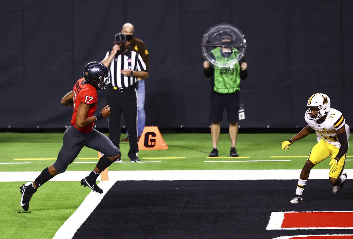 UNLV Rebels quarterback Doug Brumfield (17) scores a touchdown against the Wyoming Cowboys duri ...