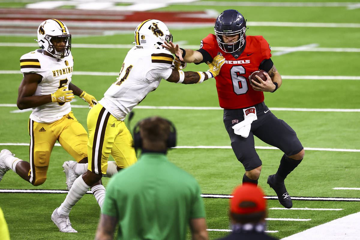 UNLV Rebels quarterback Max Gilliam (6) gets forced out of bounds by Wyoming Cowboys cornerback ...
