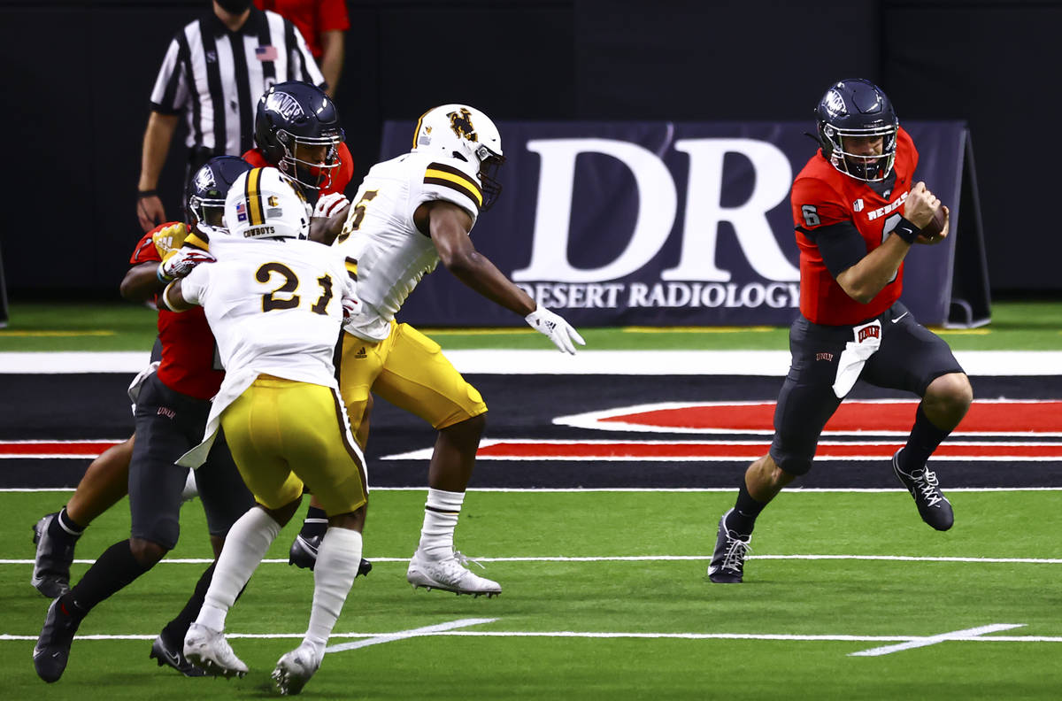 UNLV Rebels quarterback Max Gilliam (6) runs the ball against the Wyoming Cowboys during the fi ...