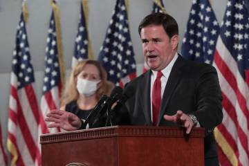 Arizona Gov. Doug Ducey addresses the media on COVID-19 during a news conference in Phoenix in ...