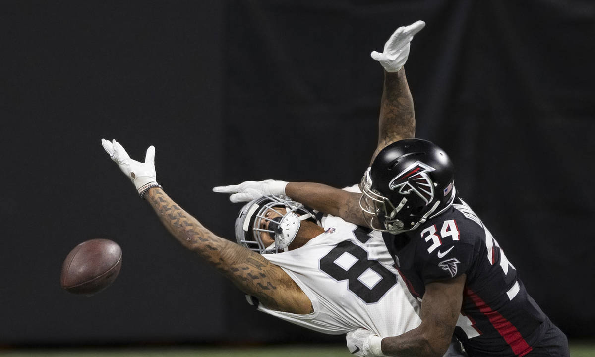Las Vegas Raiders tight end Darren Waller (83) extends to try and make a catch over Atlanta Fal ...