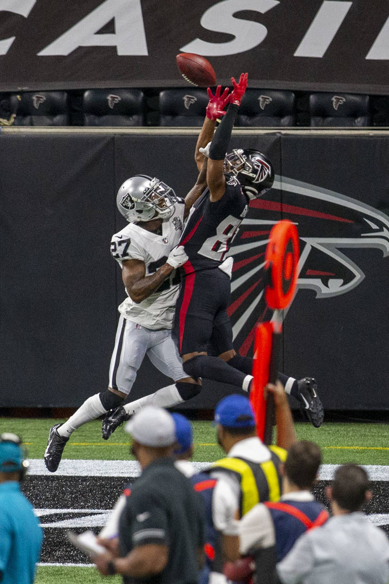 Las Vegas Raiders cornerback Trayvon Mullen (27) breaks up a pass intended for Atlanta Falcons ...