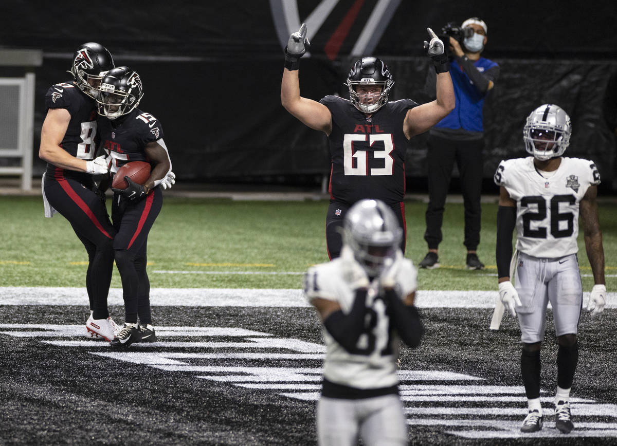 Atlanta Falcons wide receiver Brandon Powell (15) celebrates with Atlanta Falcons tight end Jae ...