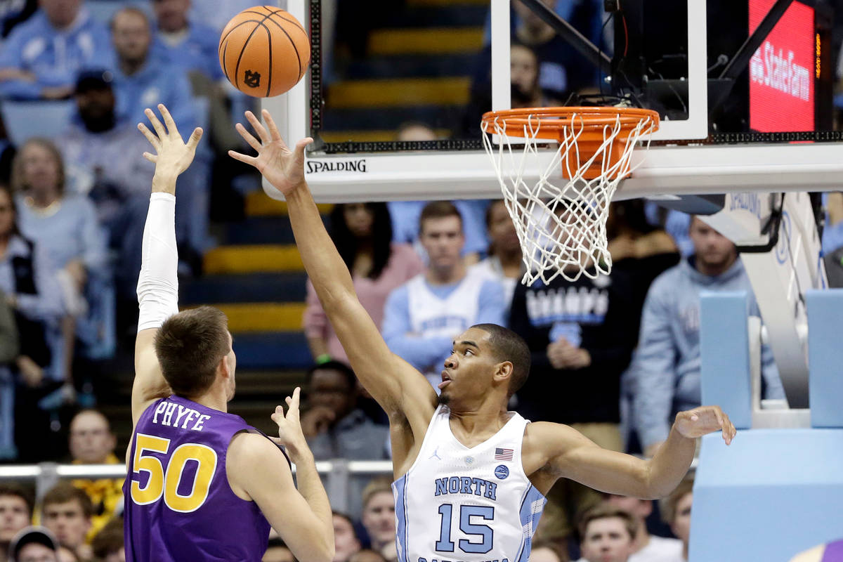 North Carolina's Garrison Brooks (15) defends while Northern Iowa's Austin Phyfe (50) shoots du ...