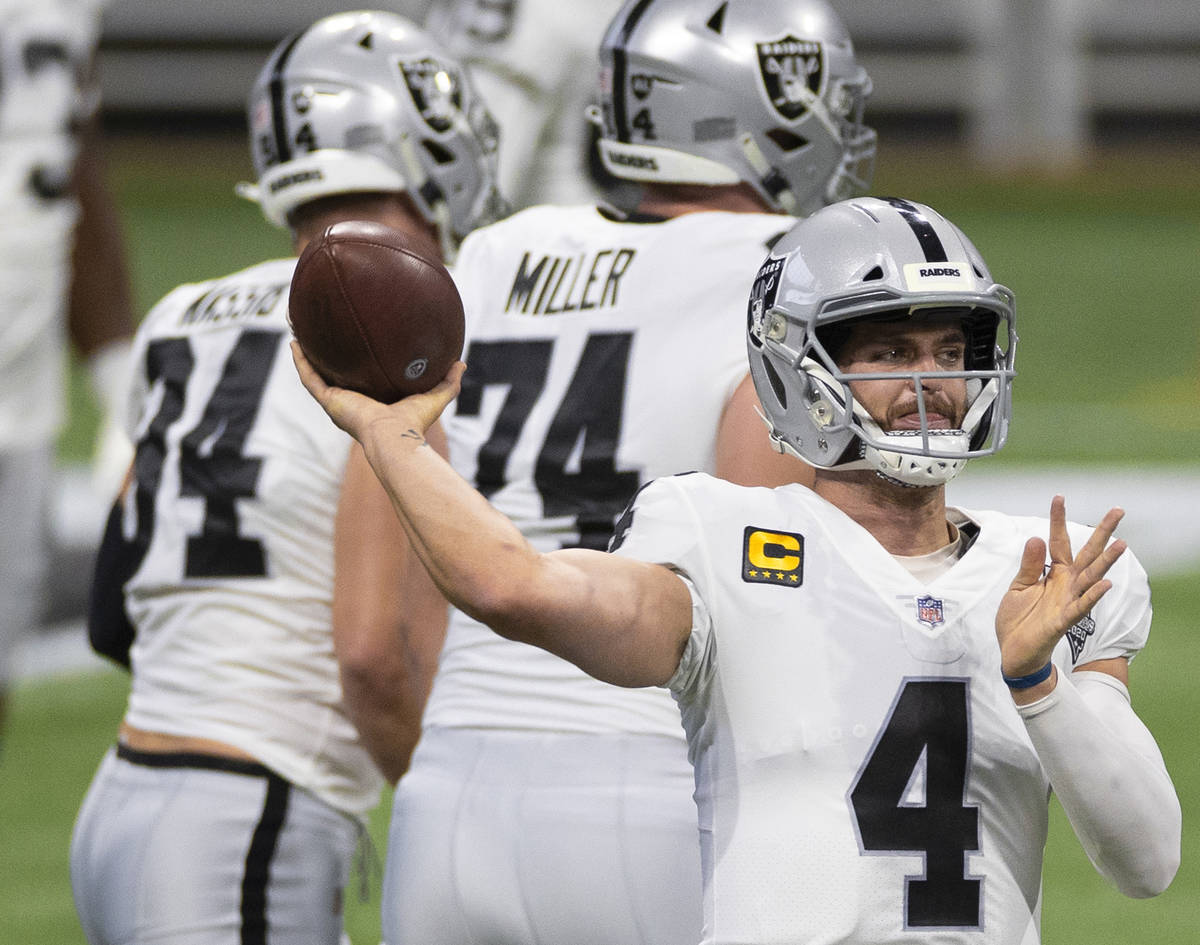 Las Vegas Raiders quarterback Derek Carr (4) warms up before the start of an NFL football game ...