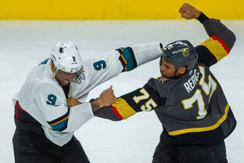 San Jose Sharks left wing Evander Kane (9) fights with Golden Knights right wing Ryan Reaves (7 ...