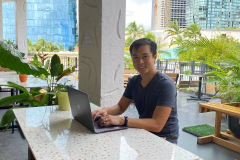 Richard Matsui works from a coworking space on Nov. 18, 2020, in Honolulu. (Ashley McCue via AP)
