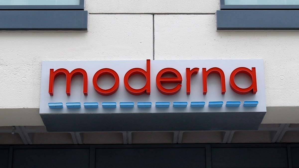 In this Monday, May 18, 2020, file photo, a sign marks an entrance to a Moderna, Inc., building ...