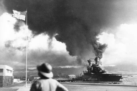 American ships burn during the Japanese attack on Pearl Harbor, Hawaii, on Dec. 7, 1942. (AP P ...