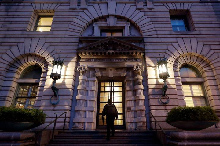 FILE - In this Feb. 9, 2017, file photo, a man walks up the steps of the 9th U.S. Circuit Court ...