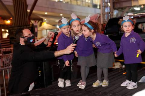 Members of the Torah Tots Preschool choir, from left, Mendel Harlig, 3, Rivka Harlig, 4, Mussie ...