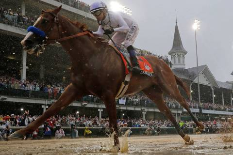 In this May 5, 2018, file photo, Mike Smith rides Justify to victory during the 144th running o ...