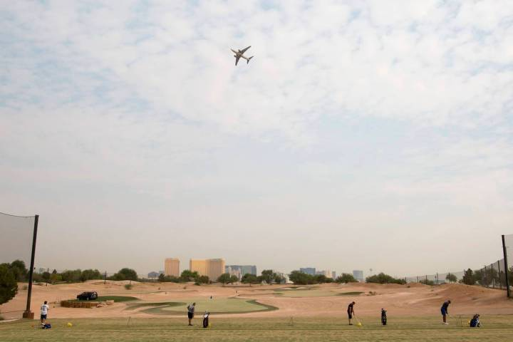 An airplane flies over Las Vegas Golf Center on Friday, Sept. 18, 2020, in Las Vegas. (Ellen Sc ...