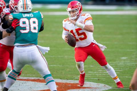 Kansas City Chiefs quarterback Patrick Mahomes (15) scrambles with the ball against Miami Dolph ...