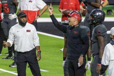 UNLV Rebels head coach Marcus Arroyo yells to his players before the first half of their NCAA f ...