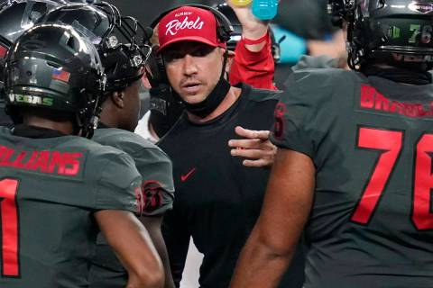 UNLV head coach Marcus Arroyo speaks with his players during the second half of an NCAA college ...
