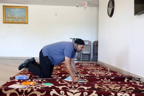 Shamsuddin Waheed, imam at Masjid Ibrahim in Las Vegas, places carpet in a social hall in Octob ...