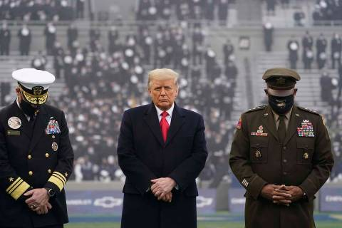 FILE - In this Dec. 12, 2020, file photo President Donald Trump stands on the field before the ...