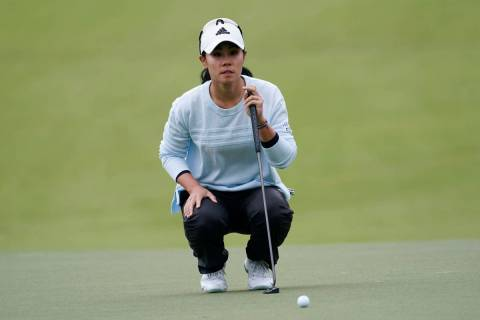 Danielle Kang lines up a putt on the first hole during the third round of the U.S. Women's Open ...