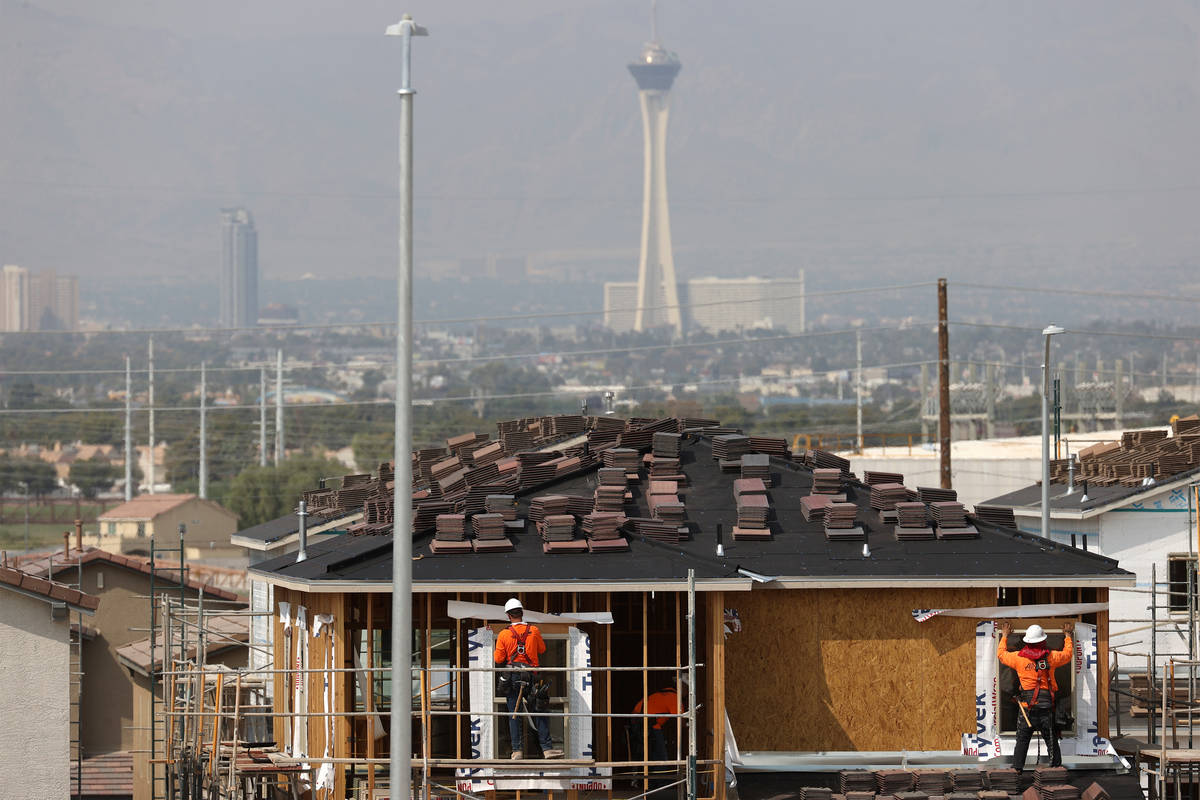 Construction workers build a home near Vegas Valley Drive and S. Hollywood Boulevard in Las Veg ...