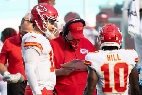 Kansas City Chiefs quarterback Patrick Mahomes (15) talks with Kansas City Chiefs head coach An ...