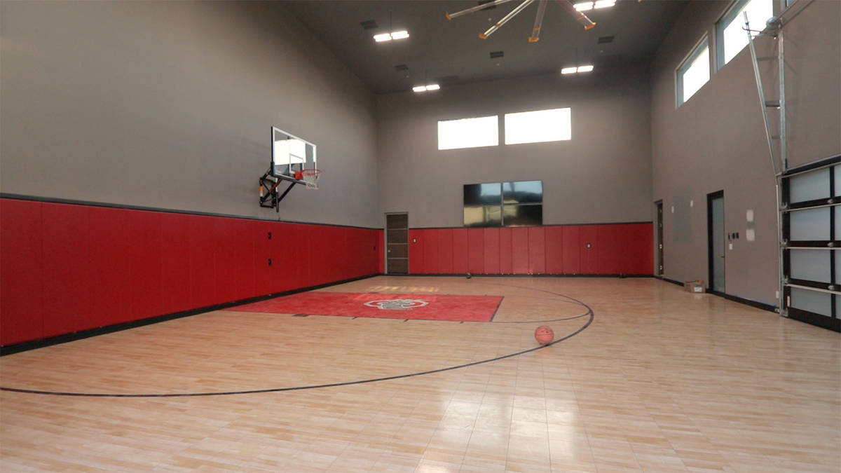 Forever Home Realty The estate has an indoor basketball court with electronic scoreboard and lo ...