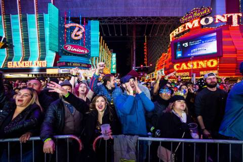 New Year's Eve revelers cheer by a stage at the Fremont Street Experience in downtown Las Vegas ...