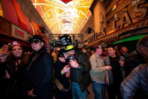 Revelers, including Karrie Wagner and James Green, of Dallas, center, celebrate during a New Ye ...