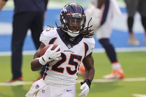 Denver Broncos running back Melvin Gordon (25) returns to the home of his former team for the f ...