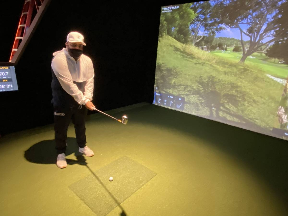 Five Iron Golf General Manager Kenny Ray is shown working out of the rough at the first hole of ...