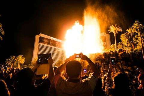 A large crowd gathers to watch the volcano erupt at The Mirage on the Strip on Tuesday, Oct. 11 ...
