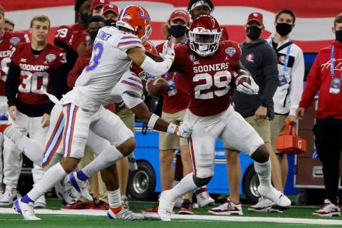 Florida defensive back Donovan Stiner attempts to stop Oklahoma running back Rhamondre Stevenso ...